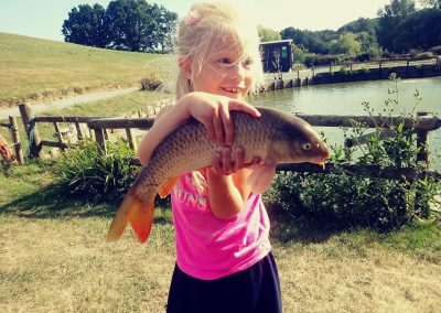 Maria with a large carp on Junior Lakes